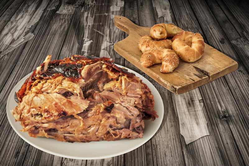 Plateful Of Spit Roasted Pork Ham And Croissant Puff Pastry Sesame Cheese Rolls On Old Cutting Board Set On Cracked Garden Table stock images