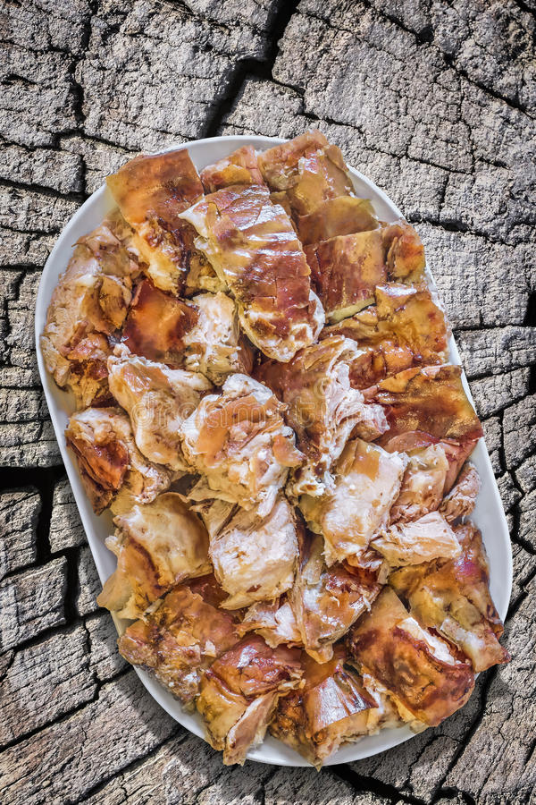 Plateful of Spit Roasted Pork Meat Slices on Old Stump Serving As Improvised Picnic Table royalty free stock photo
