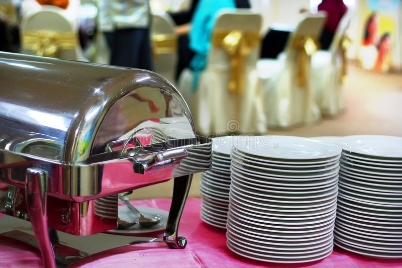 Plates and chafing. Dish at banquet for buffet royalty free stock photo