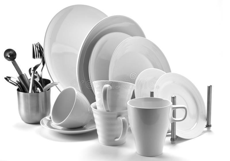 Plates & cutlery. Set of fresh washed plates and cutlery isolated on white stock photos