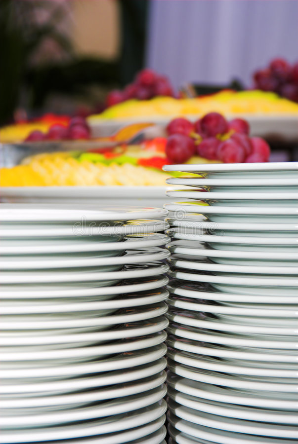 Plates and different fruits royalty free stock image