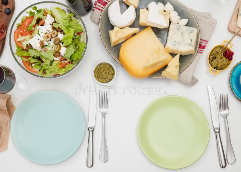 Plates on a dining table royalty free stock images