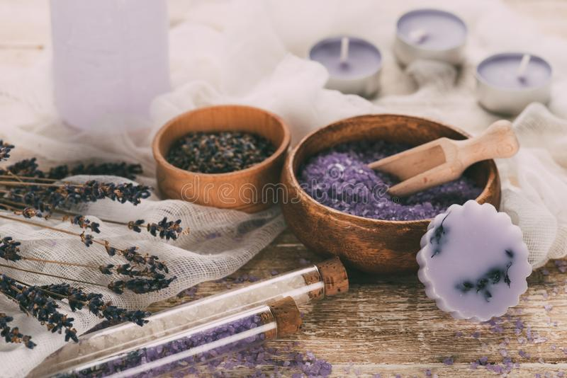 Plates with dried lavender and bathroom salt, candles stock image