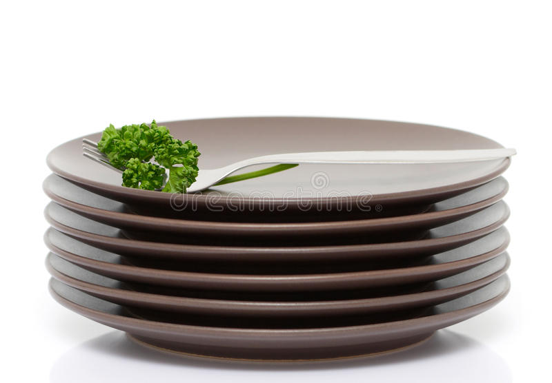 Download Plates, fork and parsley stock photo. Image of accuracy - 18566858