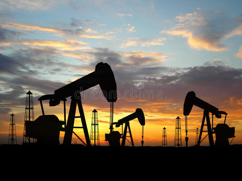 Plates-formes pétrolières de silhouette photo libre de droits