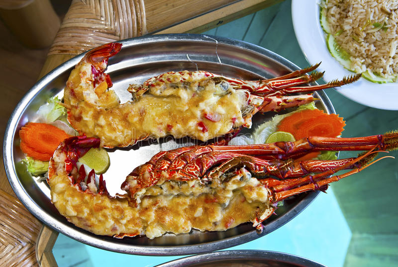 Plates with lobster on table royalty free stock photography