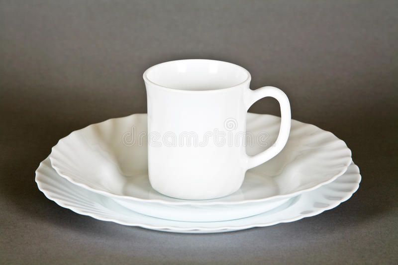 Download Plates and mug stock photo. Image of shadow, isolated - 19607776