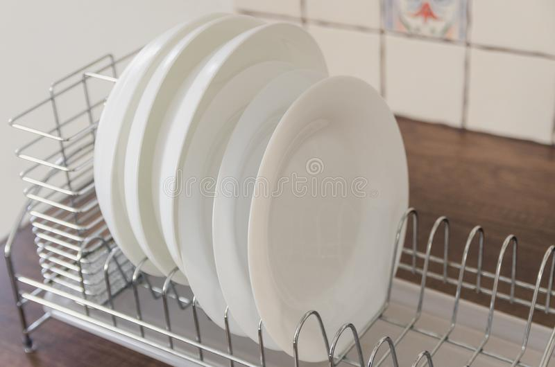 Plates in the open cabinet stock photos