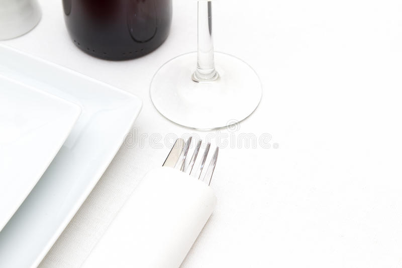 Download Plates And Red Wine On White Tablecloth Stock Photo - Image: 27169522