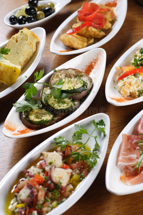Plates of Spanish tapas royalty free stock image