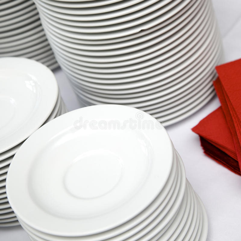 Plates stacked at buffet line royalty free stock photo