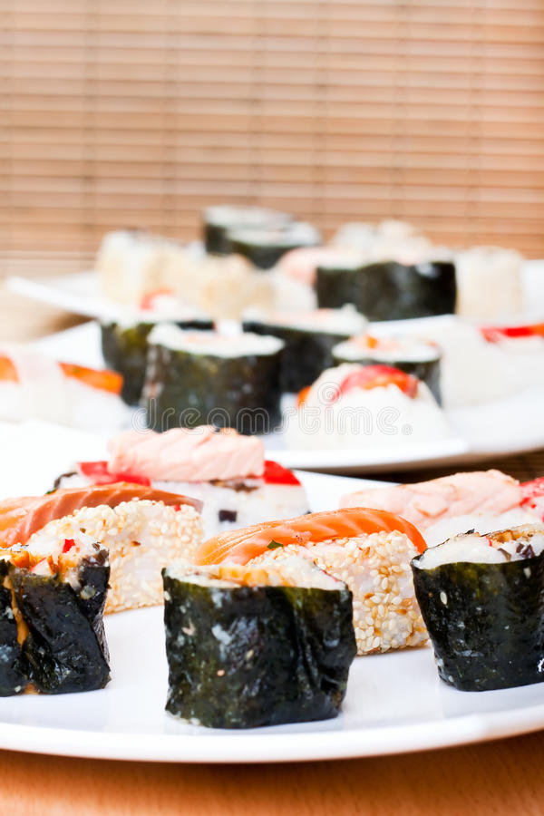 Plates with sushi rolls royalty free stock photography