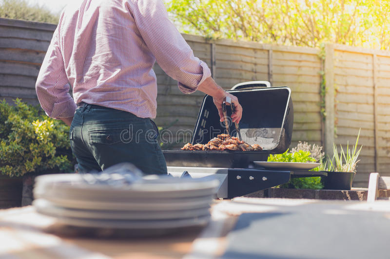 Plates on a table outside with man in background royalty free stock photo