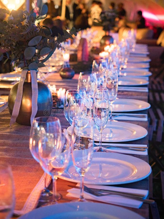 Plates and Wine Glass on Table royalty free stock photos