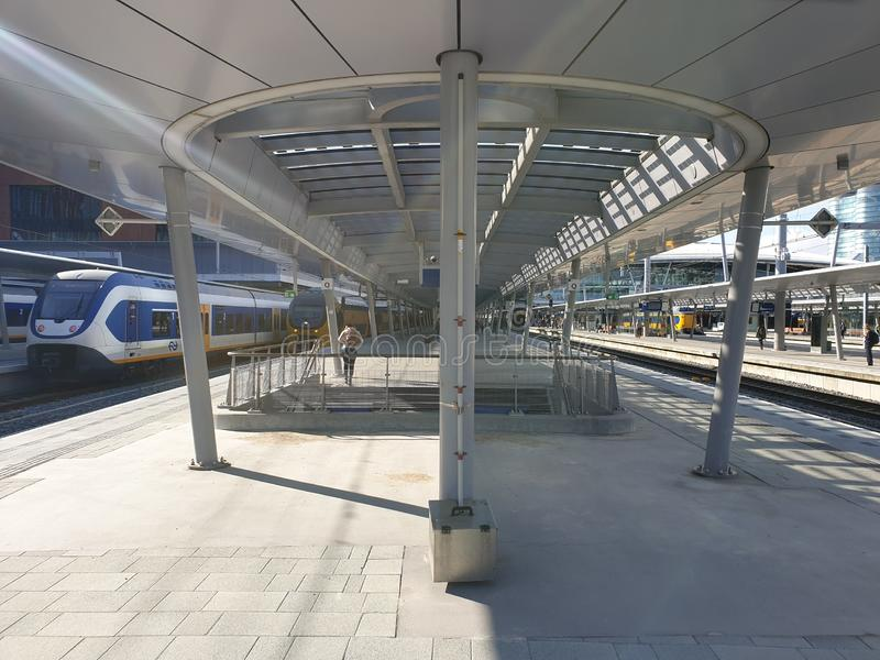 Platform of the renewed trainstation of Utrecht Centraal in the Netherlands with a train. royalty free stock photography