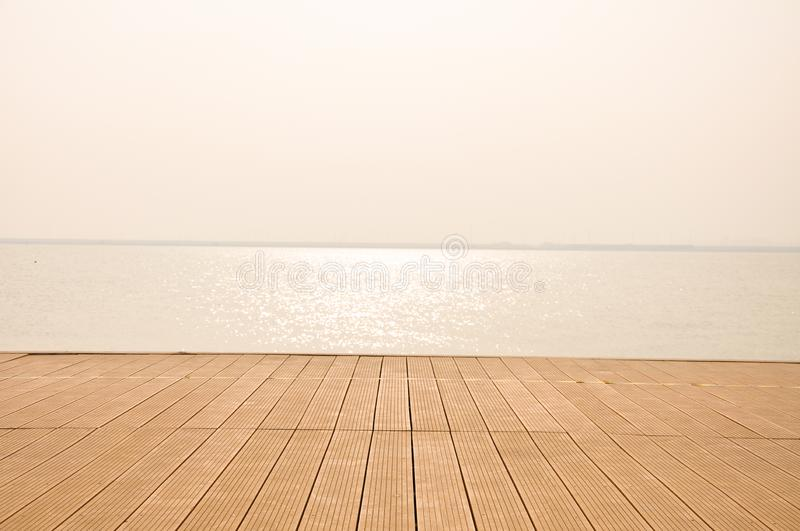 wood board on the seaside stock photos