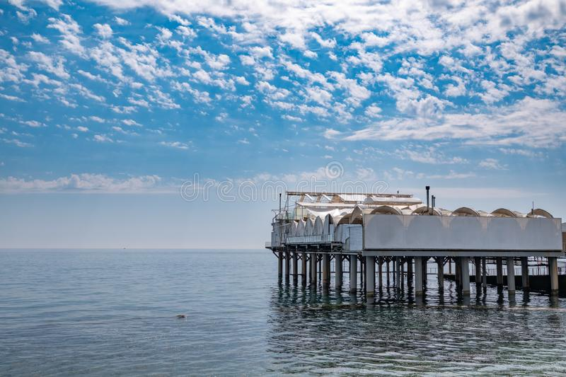 Platform on supports in the sea near the shore royalty free stock photography