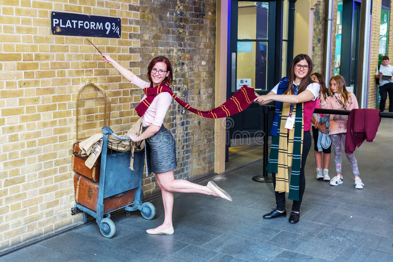 Platform 9 three-quarter from Harry Potter Movies at Kings Cross Station in London, UK royalty free stock photography