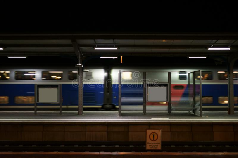 Platform with passing train royalty free stock image