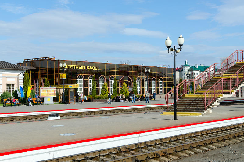 Platforms Railway Station in Mogilev, Belarus. MOGILEV, BELARUS - APRIL 25, 2015: Unidentified people are waiting to board in trains on the platform of the train royalty free stock photo