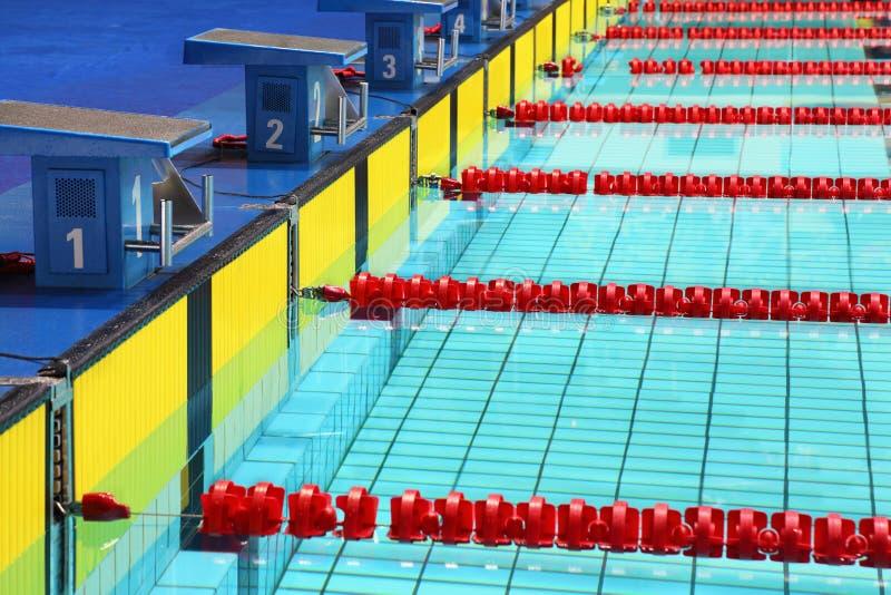 Platforms for start in swimming pool. Four platforms for start in swimming pool stock image