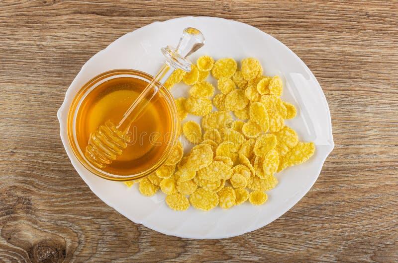 Plato con las avenas, cazo de la miel en cuenco con la miel en la tabla Visi?n superior fotografía de archivo libre de regalías