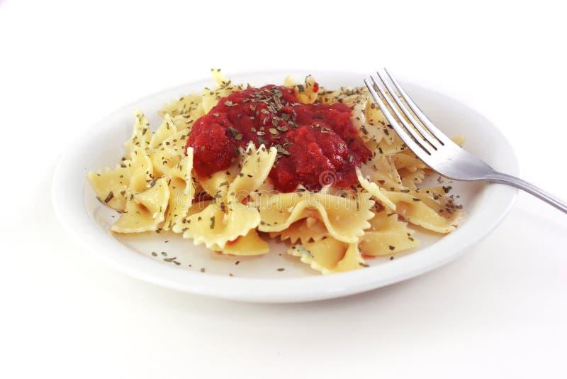 Plato de las pastas con la fork foto de archivo