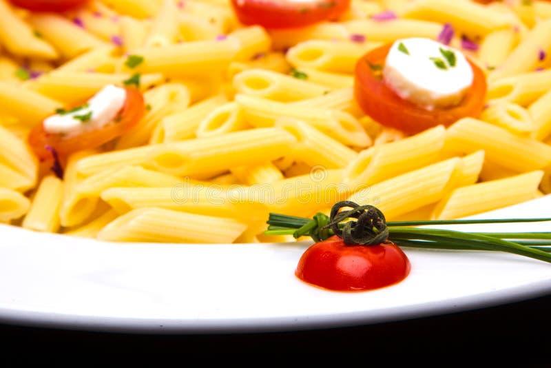 Plato de las pastas del tomate fotografía de archivo libre de regalías