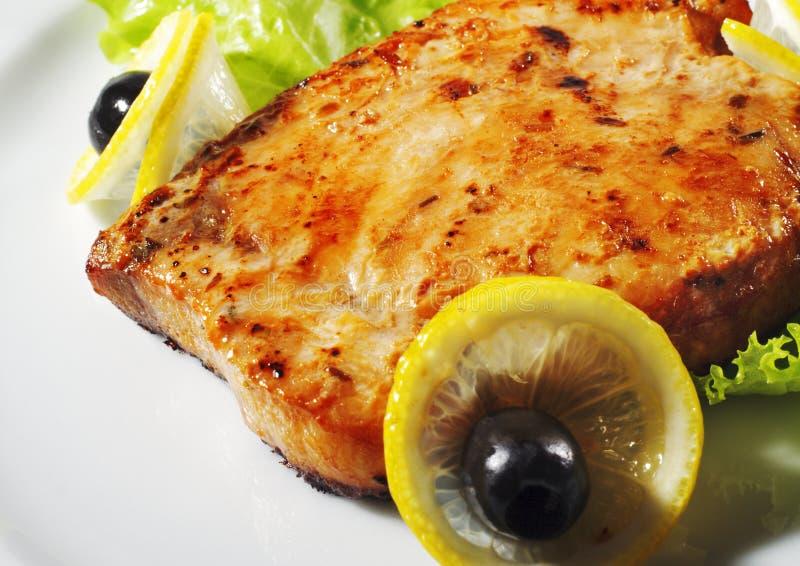 Plato de pescados caliente - filete de pescados imagenes de archivo