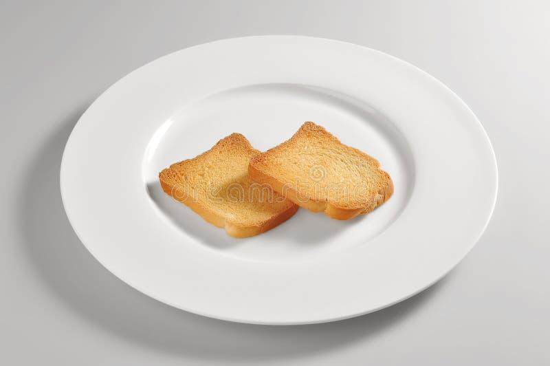 Plato redondo con la tostada de melba imagen de archivo libre de regalías