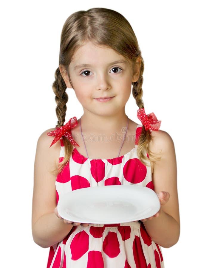 Plato vacío de la placa del control de la muchacha del niño aislado en blanco fotografía de archivo libre de regalías
