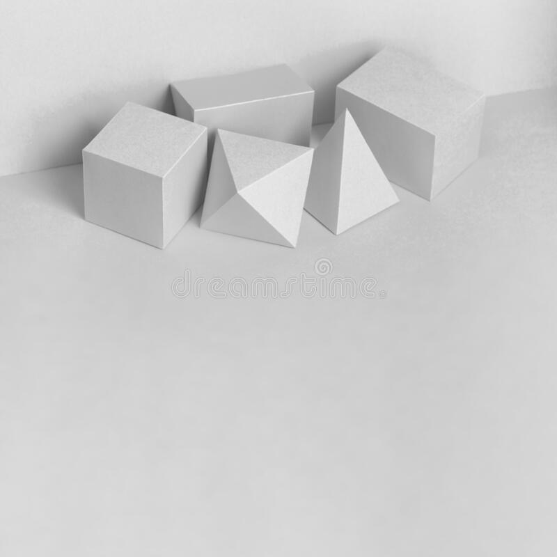 Platonic solids figures geometry. Abstract white color geometrical figures still life composition. Three-dimensional stock photography
