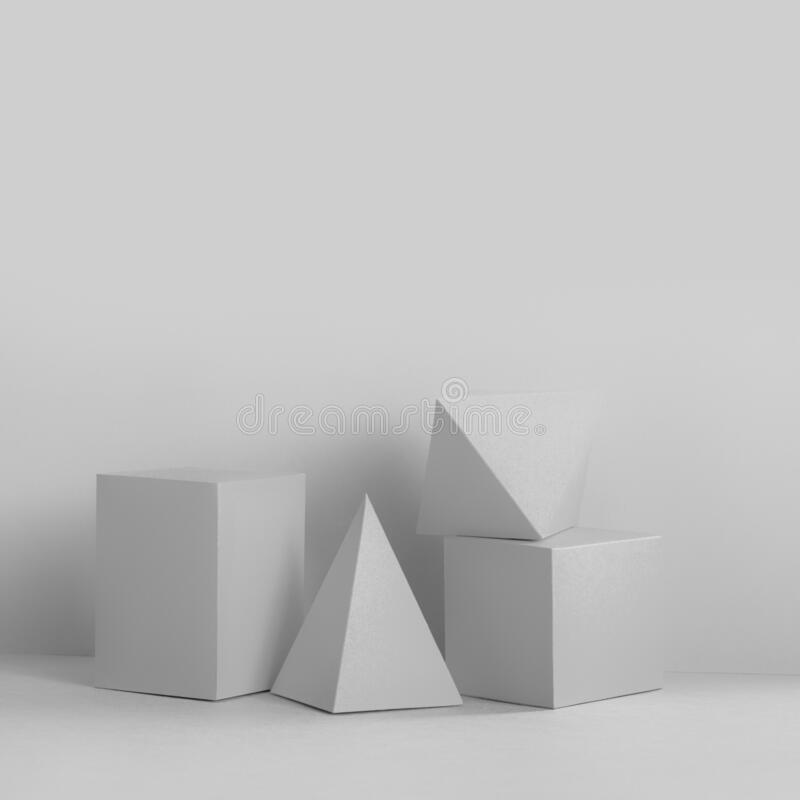 Platonic solids figures geometry. Abstract white color geometrical figures still life composition. Three-dimensional royalty free stock photos