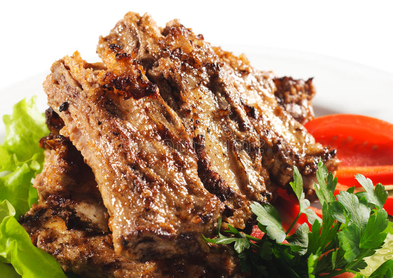 Platos calientes de la carne - carne del Bbq foto de archivo