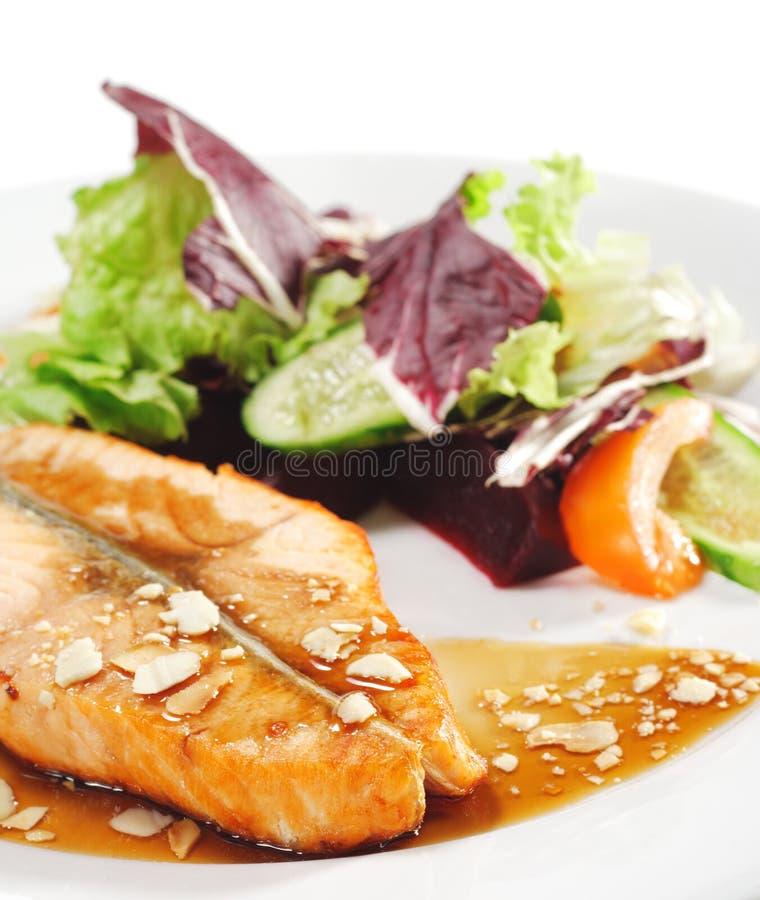 Platos de pescados calientes - filete de color salmón fotografía de archivo libre de regalías