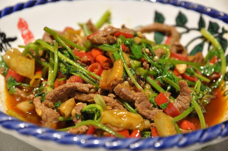 Platos huang de la carne de vaca imagenes de archivo