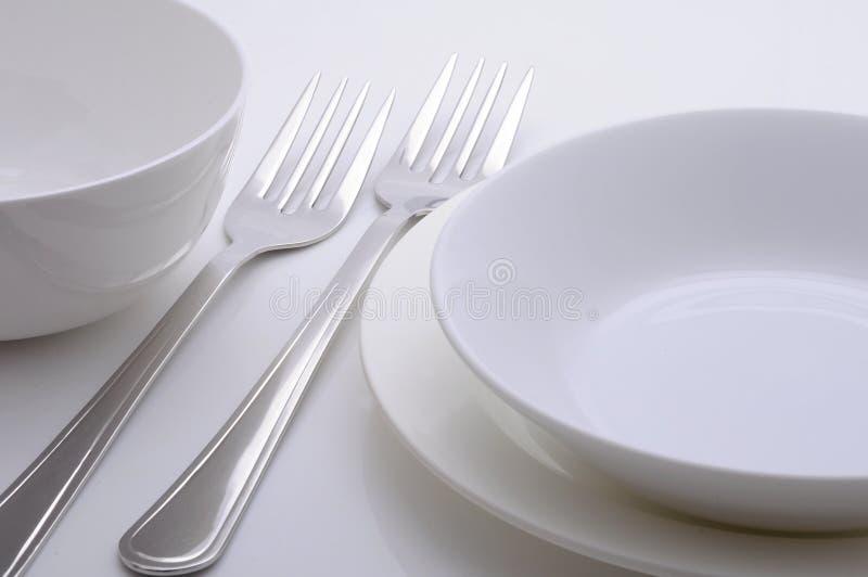 Plats de dîner photographie stock libre de droits