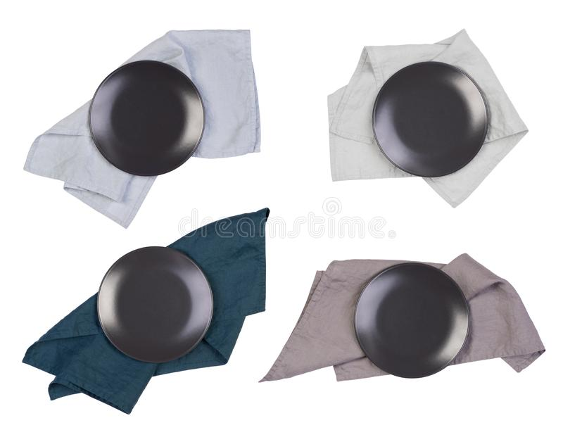 Plats noirs et serviettes d'isolement sur le fond blanc photo stock