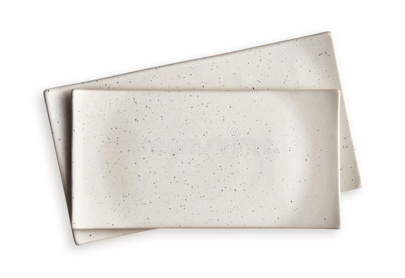 Plats rectangulaires vides, plats blancs de céramique, vue d'en haut d'isolement sur le fond blanc avec le chemin de coupure photos libres de droits