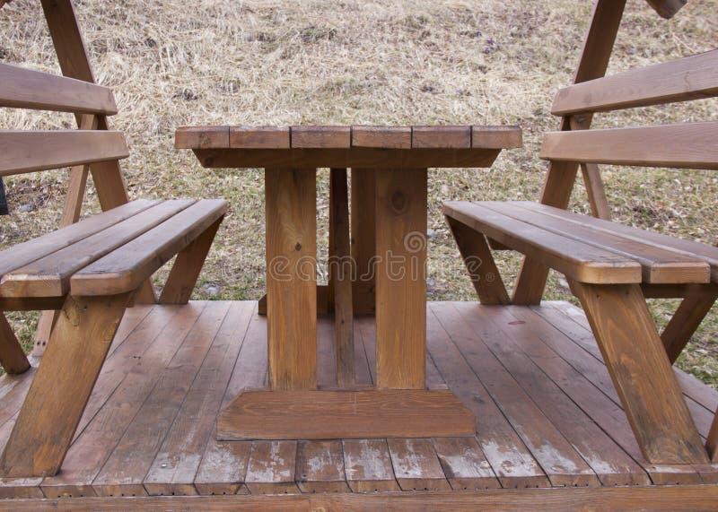 platser table tr? royaltyfri bild