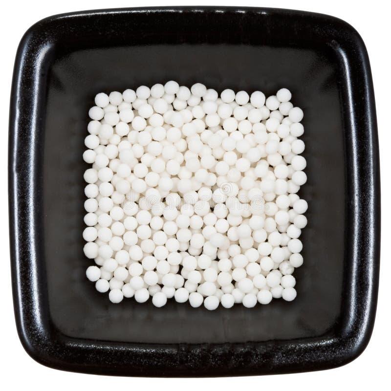 platta för homeopathy för bollblackclose upp arkivfoton