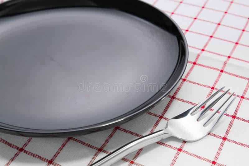 Platta och gaffel royaltyfri fotografi
