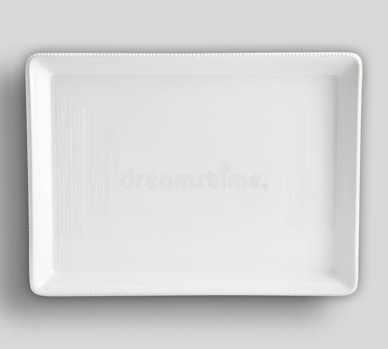Platta p? vit bakgrund - bilden, tom vit plattacirkel p? isolerad bakgrund - bild arkivbilder