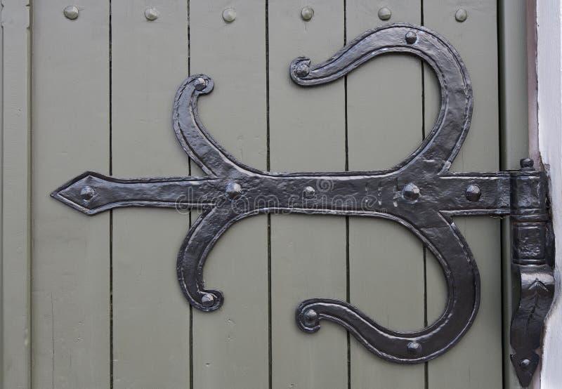 Platte auf Kirchen-Tür stockfotografie