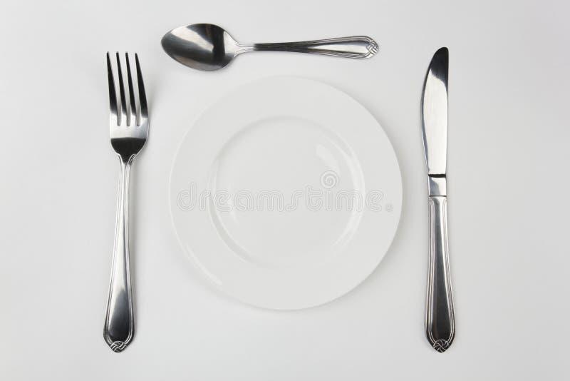 Platte, Gabel, Messer und Löffel stockfoto