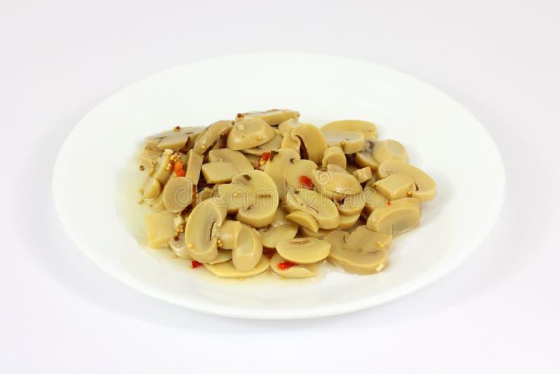 Platte marinierte Pilze lizenzfreies stockbild