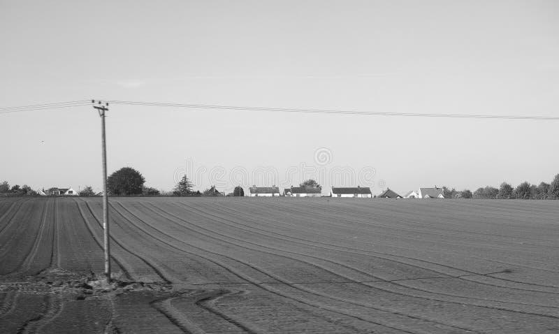 Platteland dichtbij Cambridge in zwart-wit stock foto's