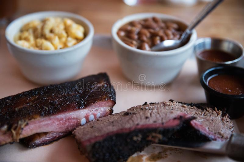 Barbecue Pork Ribs and Beef Brisket. Platter of barbecue beef brisket and pork ribs royalty free stock image
