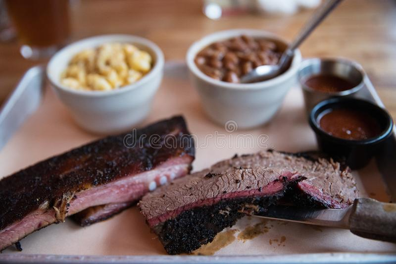 Beef Brisket and Pork Ribs Barbecue. Platter of barbecue beef brisket and pork ribs stock image