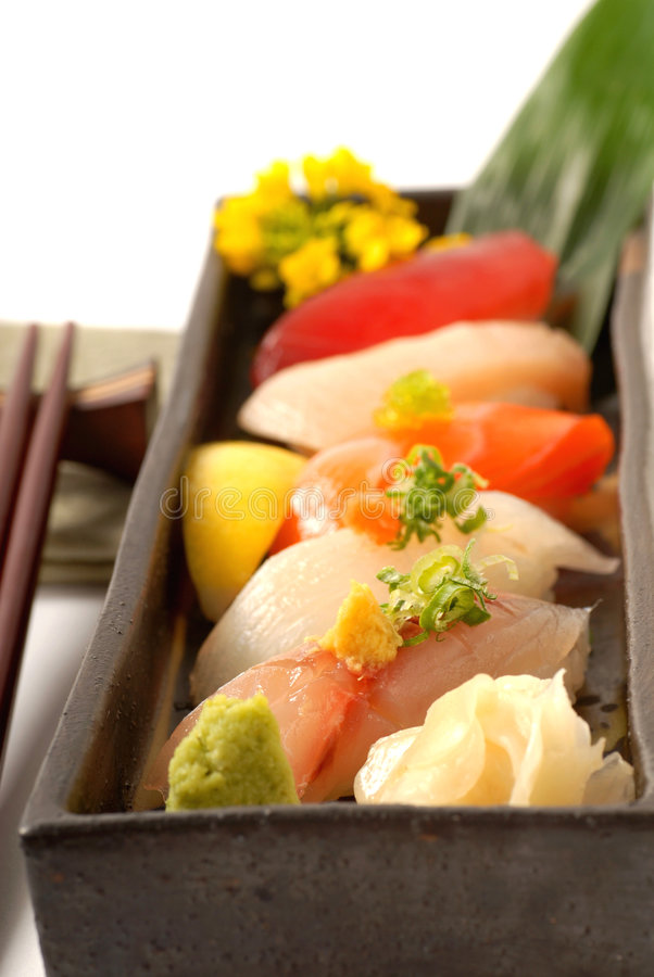 Platter of fresh Japanese sushi with wasabi stock photography